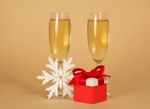 Wine glasses with champagne, a red gift box Stock Images
