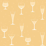 Wine glasses with champagne on yellow background Royalty Free Stock Images