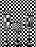 Wine glasses on a checkered background Royalty Free Stock Photos
