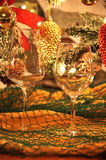 Wine glasses with Christmas decoration. Christmas decoration in house area Royalty Free Stock Photo