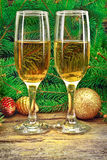Wine glasses, Christmas toys, near  New Year tree Stock Photo