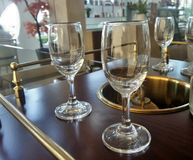 Wine glasses. Clear wine glasses on drink trolley Stock Images