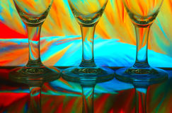 Wine glasses with colorful background Stock Image
