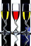 Wine glasses with colorful liqueur Royalty Free Stock Photos
