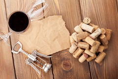 Wine glasses, corks, corkscrew and piece of paper Royalty Free Stock Images