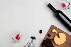 Wine, glasses and corkscrew over white background. Top view Stock Photo