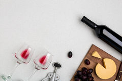 Wine, glasses and corkscrew over white background. Top view Stock Photos