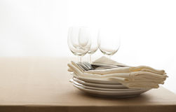 Wine glasses, cutlery, plates and napkins Royalty Free Stock Images