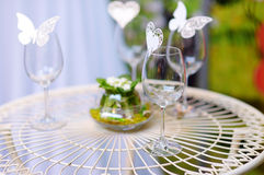 Wine glasses decorated with paper butterflies Stock Images