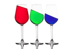WIne glasses with different coloured drinks. Three different colored wine glasses isolated on white. Red, green and blue - RGB. WIne glasses with different royalty free stock photos