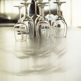 Wine glasses on dinner table. Group of wine glasses on dinner table in restaurant stock photos