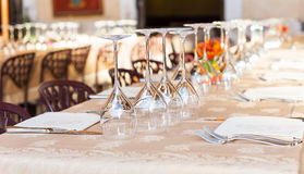Wine glasses on a festive table in a restaurant in Rome Stock Image