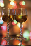 Wine glasses in front of colorful background Stock Photo