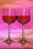 Wine glasses in front of lighted background Stock Photos