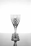 Wine glasses on glossy table surface Stock Images