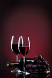 Wine in glasses with grape and bottle Royalty Free Stock Image