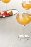 Wine glasses of grapefruit juice with ice cubes and rosemary Royalty Free Stock Photography