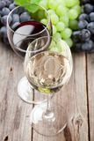 Wine glasses and grapes Royalty Free Stock Images
