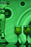 Wine glasses with green retro background Stock Images