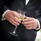 Wine glasses  hand bride and groom. Royalty Free Stock Images