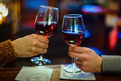 Wine glasses in hand royalty free stock photos
