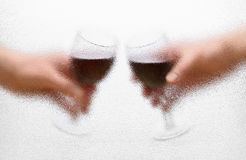 Wine glasses in the hands Stock Image