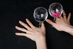 Wine glasses in hands stock photo