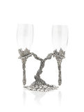 Wine glasses hang on beautiful pewter stand Stock Photo