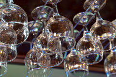 Wine glasses hanging above the bar rack Royalty Free Stock Photography