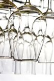 Wine glasses lined up. On the white Stock Photo