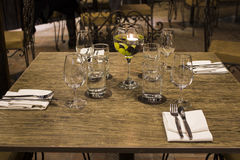 Wine glasses with napkins, glasses and gourmet food, banquet table Royalty Free Stock Images