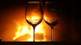 Wine glasses near fireplace stock video footage