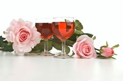 Wine glasses with pink roses Royalty Free Stock Photo