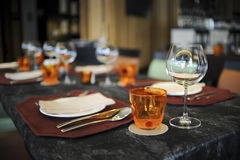 Wine Glasses and plates on table Royalty Free Stock Image