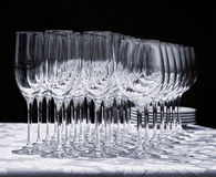 Wine glasses with plates on the table. Royalty Free Stock Images