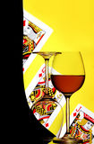 Wine glasses and playing cards royalty free stock image
