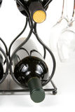 Wine and glasses on a rack. On a white background royalty free stock photo