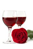 Wine glasses and red rose isolated Royalty Free Stock Photography