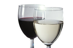 Wine in glasses. Red and white wine in pair of winw glasses on plain background Royalty Free Stock Image