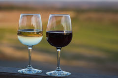 Wine Glasses. Glasses of red and white wine on patio of Blenheim Vineyards Charlottesville Virginia Royalty Free Stock Images