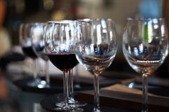 Wine glasses. Red wine and white wine. Wine glasses in a small inner city cafe Royalty Free Stock Photography