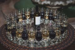 Wine glasses with red and white wine. At a party royalty free stock photography