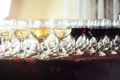 Wine glasses with red and white wine.  stock images