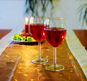 Wine glasses with red wine and christmas decoration Stock Photography