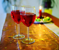 Wine glasses with red wine and christmas decoration Stock Photo