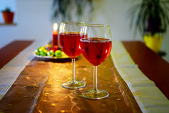 Wine glasses with red wine and christmas decoration Stock Image