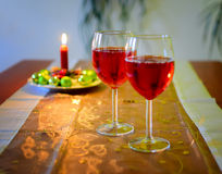 Wine glasses with red wine and christmas decoration Stock Photos