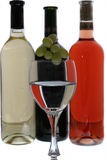 Wine glasses with reflection of  wine bottles. Red rose and withe wine  bottles Royalty Free Stock Images