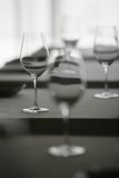Wine Glasses in Restaurant. Four wine glasses sitting on a restaurant table. Selective focus has been used to isolate one of the glasses. Image is shot in colour stock photo