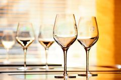 Wine glasses on the restaurant tables Royalty Free Stock Photography